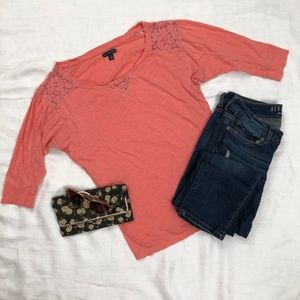 Pink three quarter length sleeve shirt